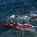 red-sea-kayak-on-dark-sea